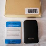 Packaging de la batterie de secours TeckNet IEP390 9000mAh, avec câble USB / micro-usb, connecteurs / adaptateurs et notice.